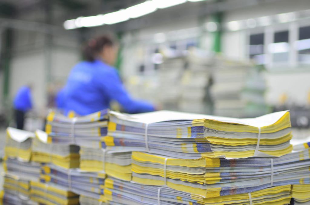 Stuck of newspaper magazine in print production process