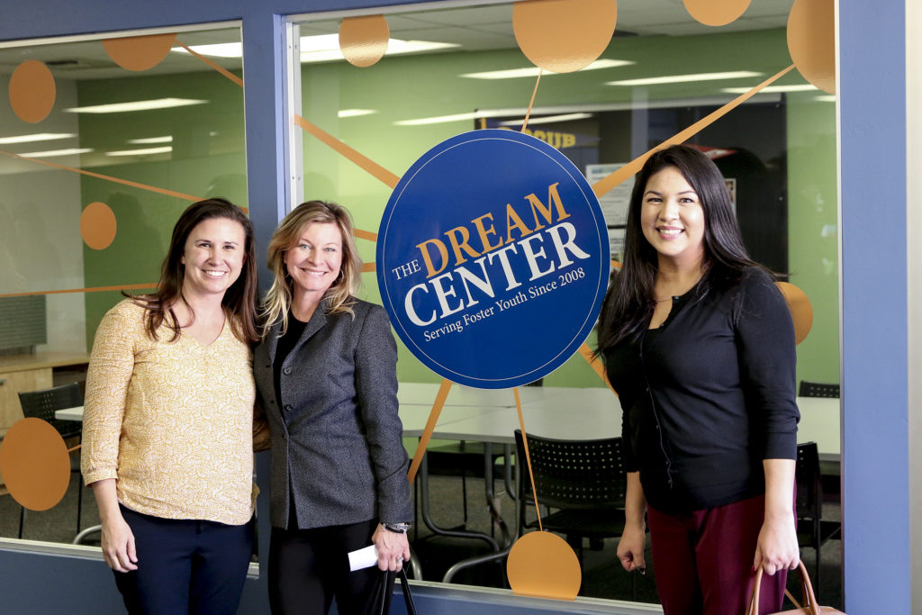 3 Women in front of Dream Center