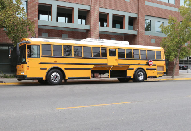 KCSOS charter-style school bus with storage opened