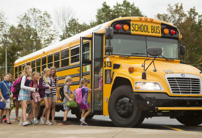 Students loading the yellow school bus